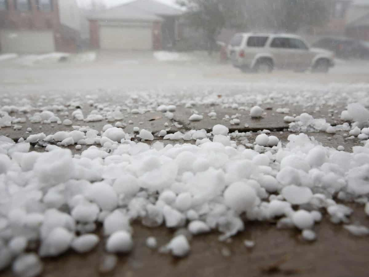 a hail storm resulting in hail on a driveway