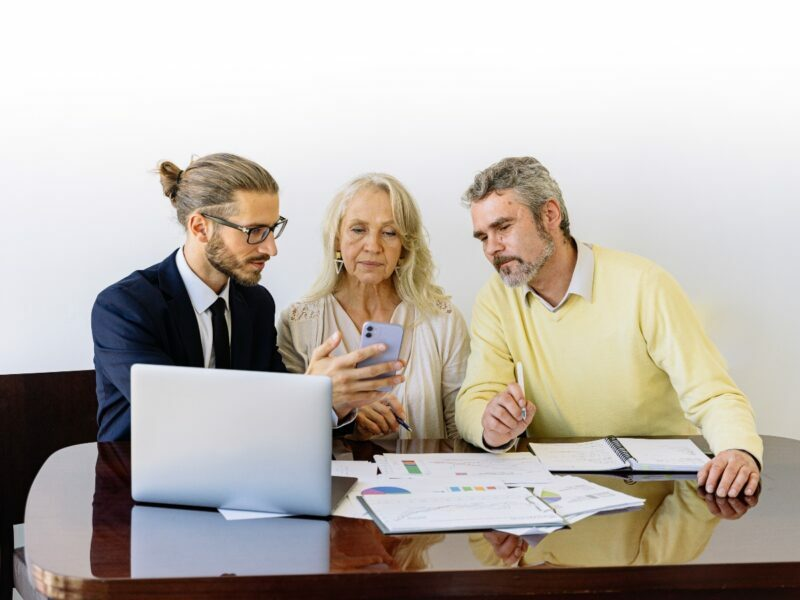 an insurance agent sits down with two people to explain how does insurance work