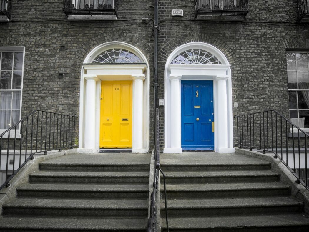 two doors, one blue and one yellow that lead to homes