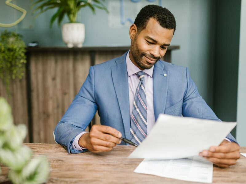 an insurance agent or worker looking over the insurance policy or contract