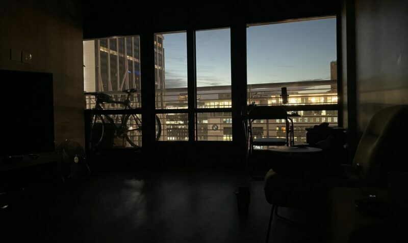 The living area of a dark apartment with no lights on.