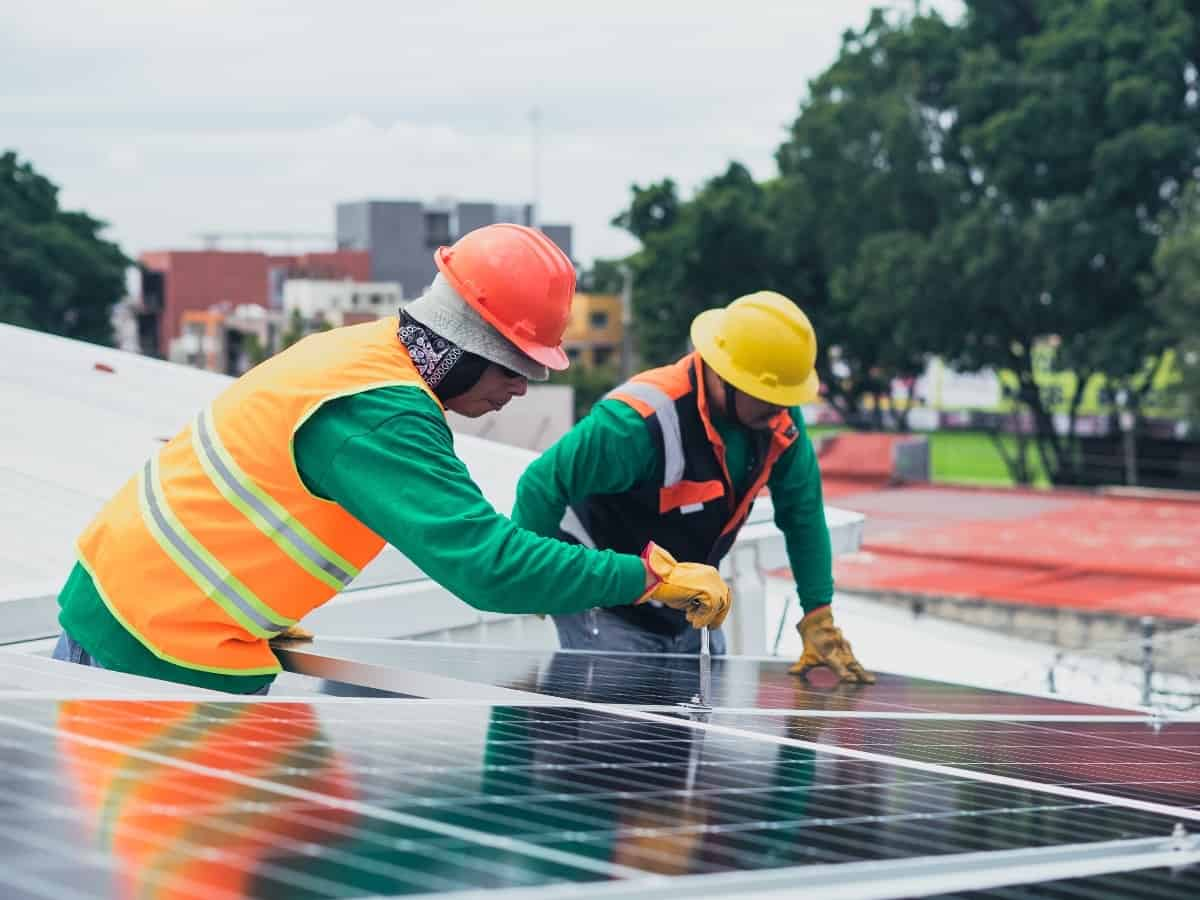 two men working on solar panel installation to make sure it's well maintained with a long lifespan