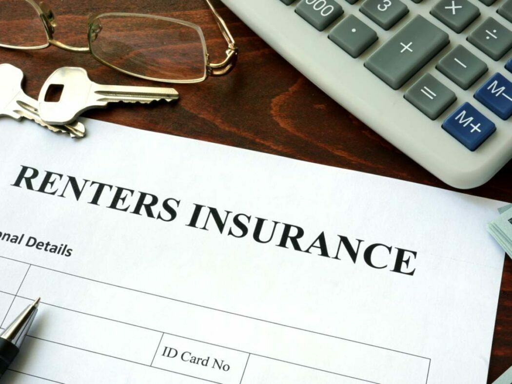 a renters insurance form with house keys, and a calculator